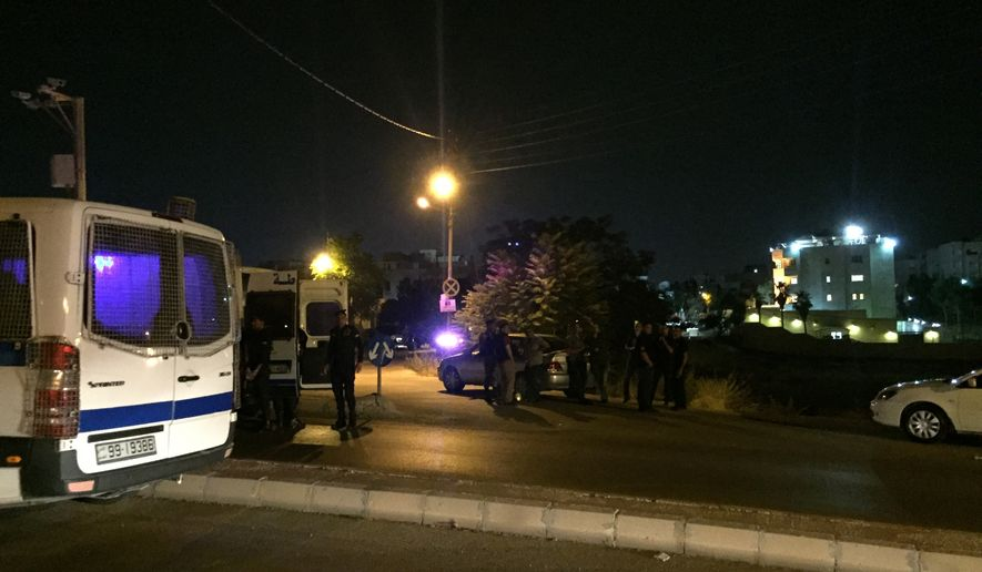 Security officials park near the approach toward the Israeli Embassy in Amman, Jordan, on Sunday, June 23, 2017, in the aftermath of a shooting that left a Jordanian man dead and an Israeli man wounded. A security official confirmed a Jordanian had been killed and an Israeli wounded, but would not provide further details. He spoke on condition of anonymity because he was not authorized to discuss the incident with the media. (AP Photo/Omar Akour)