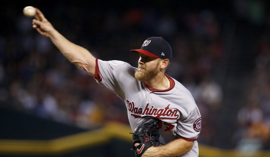 Washington Nationals' Stephen Strasburg throws a pitch against the Arizona Diamondbacks during the first inning of a baseball game Sunday, July 23, 2017, in Phoenix. (AP Photo/Ross D. Franklin)