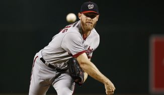 Washington Nationals' Stephen Strasburg warms up during the first inning of a baseball game Sunday, July 23, 2017, in Phoenix. Strasburg had to leave the game due to injury after pitching the second inning, but the Nationals defeated the Diamondbacks 6-2. (AP Photo/Ross D. Franklin)