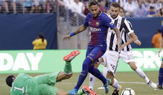 Barcelona's Neymar, center, attacks as Juventus goalkeeper Gianluigi Buffon, left, tries to block his shot during the first half of an International Champions Cup soccer match, Saturday, July 22, 2017, at MetLife Stadium in East Rutherford, N.J. Juventus' Andrea Barzagli, right, helps defend on the play. (AP Photo/Julio Cortez)