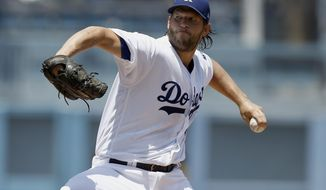 Los Angeles Dodgers starting pitcher Clayton Kershaw throws to the plate during the first inning of a baseball game against the Atlanta Braves in Los Angeles, Sunday, July 23, 2017. (AP Photo/Alex Gallardo)