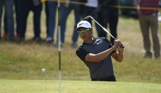 China's Haotong Li plays out of a bunker on the 4th hole during the third round of the British Open Golf Championship, at Royal Birkdale, Southport, England, Saturday July 22, 2017. (AP Photo/Dave Thompson)