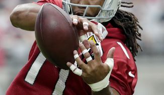 FILE - This July 22, 2017 file photo shows Arizona Cardinals wide receiver Larry Fitzgerald running drills during the first day of NFL football training camp in Glendale, Ariz. Fitzgerald is still producing at a high level as his career winds down, but hasn't yet decided when he will retire. (AP Photo/Matt York, file)