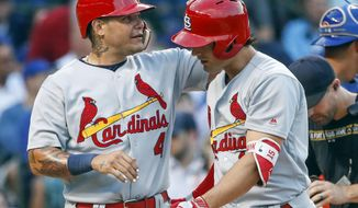 St. Louis Cardinals' Randal Grichuk, right, celebrates with Yadier Molina, left, after hitting two-run home run off Chicago Cubs starting pitcher Jose Quintana during the second inning of a baseball game, Sunday, July 23, 2017, in Chicago. Molina scored on a play. (AP Photo/Kamil Krzaczynski)