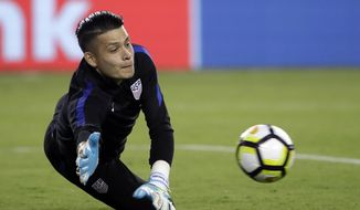 U.S. goalie Jesse Gonzalez warms up for a CONCACAF Gold Cup quarterfinal soccer match against El Salvador, in Philadelphia, Wednesday, July 19, 2017. After starting at the 2015 Under-20 World Cup for Mexico, the land of his parents, 22-year-old FC Dallas goalkeeper Jesse Gonzalez switched his affiliation this summer to the United States, where he grew up. Gonzalez wanted to play for the nation where he felt most comfortable. (AP Photo/Matt Rourke)