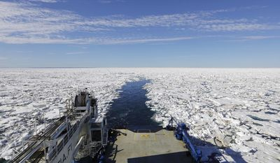 The Finnish icebreaker MSV Nordica leaves a wake after sailing through sea ice floating on the Victoria Strait while traversing the Arctic's Northwest Passage, Friday, July 21, 2017. The AP is accompanying a group of international researchers is sailing into the Arctic Sea aboard the Finnish icebreaker to traverse the Northwest Passage and record the environmental and social changes that are taking place in one of the most forbidding corners of the world. (AP Photo/David Goldman)