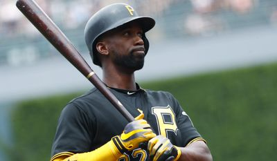Pittsburgh Pirates' Andrew McCutchen reacts after swinging and missing a pitch from Colorado Rockies starter Kyle Freeland in the first inning of a baseball game Sunday, July 23, 2017, in Denver.(AP Photo/David Zalubowski)