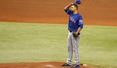 Texas Rangers starting pitcher Tyson Ross reacts after giving up a two-run double to Tampa Bay Rays' Mallex Smith during the fourth inning of a baseball game Sunday, July 23, 2017, in St. Petersburg, Fla. (AP Photo/Mike Carlson)