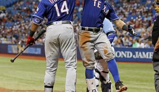 Texas Rangers' Rougned Odor, right, celebrates his two-run home run with Carlos Gomez during the eighth inning of a baseball game against the Tampa Bay Rays, Sunday, July 23, 2017, in St. Petersburg, Fla. (AP Photo/Mike Carlson)