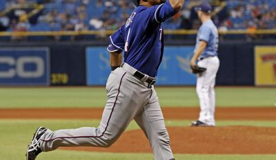 Texas Rangers' Carlos Gomez celebrates after hitting a home run off Tampa Bay Rays relief pitcher Brad Boxberger during the eighth inning of a baseball game Sunday, July 23, 2017, in St. Petersburg, Fla. (AP Photo/Mike Carlson)