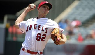 Los Angeles Angels starter Parker Bridwell delivers to the Boston Red Sox in the first inning of a baseball game in Anaheim, Calif., Sunday, July 23, 2017. (AP Photo/Reed Saxon)