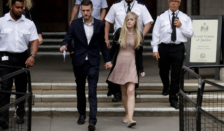 Connie Yates and Chris Gard, the parents of critically ill baby Charlie Gard, dropped their legal bid Monday after medical tests showed that the window of opportunity to help him had closed. (Associated Press)