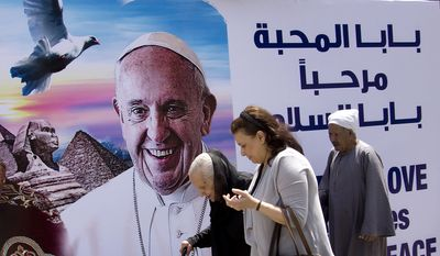 A billboard welcomes Pope Francis, at St. Mark's Cathedral in Cairo, Egypt, Thursday, April 27, 2017. On Friday, Francis is scheduled to begin a two-day pilgrimage to Egypt aimed at lifting the spirits of Christians in the Middle East, whose numbers have rapidly dwindled in recent decades due to war, displacement and emigration. The visit will include a meeting with Egypt's president and the Grand Imam of Al-Azhar as well as a Mass in a stadium on the outskirts of Cairo. (AP Photo/Amr Nabil)