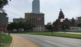 The Dallas skyline as seen from Dealey Plaza, the infamous site of President John F. Kennedy's assassination.  (Eric Althoff/The Washington Times)