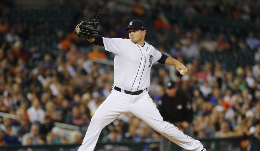 Detroit Tigers relief pitcher Justin Wilson (38) throws against the Kansas City Royals in the ninth inning of a baseball game in Detroit, Monday, July 24, 2017. (AP Photo/Paul Sancya)
