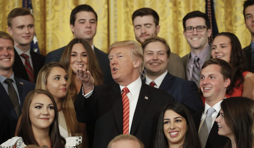 President Donald Trump speaks while posing for a photo with outgoing White House interns in the East Room of the White House in Washington, Monday, July 24, 2017. (AP Photo/Pablo Martinez Monsivais)