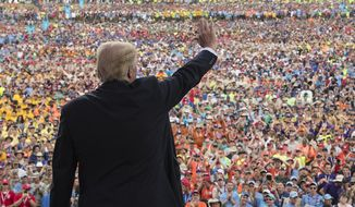 President Donald Trump waves to the crowd after speaking at the 2017 National Scout Jamboree in Glen Jean, W.Va., Monday, July 24, 2017. (AP Photo/Carolyn Kaster)