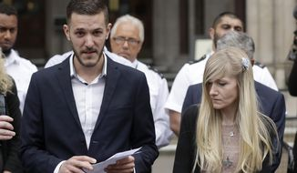 Chris Gard, the father of critically ill baby Charlie Gard finishes reading out a statement next to mother Connie Yates, right, at the end of their case at the High Court in London, Monday, July 24, 2017. The parents of critically ill baby Charlie Gard dropped their legal bid Monday to send him to the United States for an experimental treatment after new medical tests showed that the window of opportunity to help him had closed. (AP Photo/Matt Dunham)