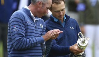 Winner Jordan Spieth of the United States, right, and runner up Matt Kuchar of the United States look at the trophy after the final round of the British Open Golf Championship, at Royal Birkdale, Southport, England, Sunday July 23, 2017. (AP Photo/Dave Thompson)