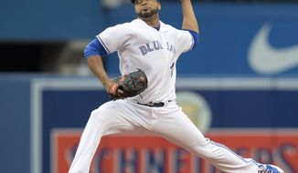 Toronto Blue Jays starting pitcher Francisco Liriano throws against the Oakland Athletics during the first inning of a baseball game in Toronto, Monday, July 24, 2017. (Fred Thornhill/The Canadian Press via AP)
