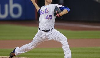 New York Mets starting pitcher Zack Wheeler (45) delivers against the Oakland Athletics during the first inning of a baseball game, Saturday, July 22, 2017, in New York. (AP Photo/Julie Jacobson)