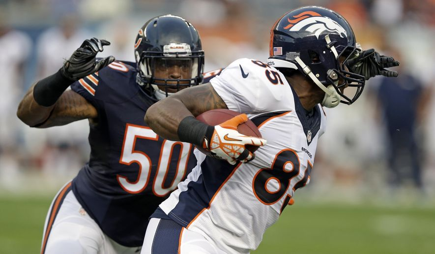 FILE - In this Aug. 11, 2016, file photo, Denver Broncos wide receiver Kieren Duncan (85) is tacked by Chicago Bears linebacker Jerrell Freeman (50) during the first half of an NFL preseason football game in Chicago. Freeman says he saved a man who was choking by performing the Heimlich maneuver at a Texas airport on Sunday, July 23, 2017. (AP Photo/Michael Conroy, File)
