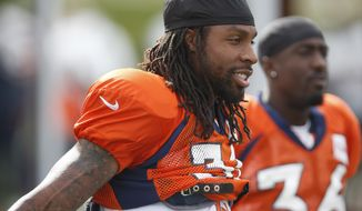 FILE - In this Thursday, Aug. 6, 2015, file photo, Denver Broncos strong safety David Bruton takes a break during drills at the team's NFL football training camp in Englewood, Colo. Bruton, who left the Broncos to play for the Washington Redskins last season, announced that he will retire on Monday, July 24, 2017.  (AP Photo/David Zalubowski, File)