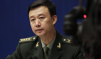 China's defense ministry spokesman Wu Qian speaks during a news conference at the State Council Information Office in Beijing, Monday, July 24, 2017. China is warning India not to underestimate its determination to safeguard what it considers sovereign territory amid an ongoing standoff between the two neighbors over a contested region high in the Himalayas. (AP Photo/Andy Wong)