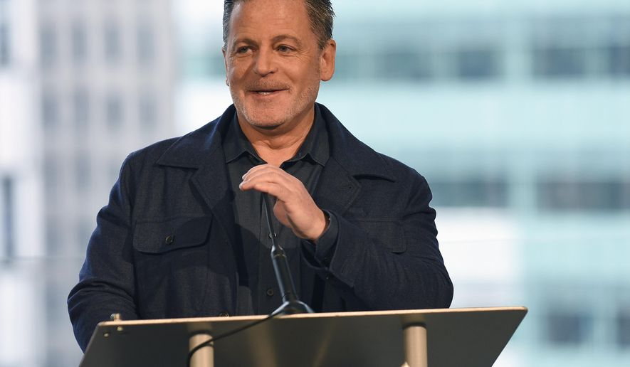 """FILE - In this Feb. 3, 2017, file photo, billionaire businessman Dan Gilbert speaks at a news conference in Detroit. Gilbert, founder of Quicken Loans Inc. and the majority owner of the Cleveland Cavaliers, apologized for his real estate company's controversial sign in downtown Detroit that says """"See Detroit Like We Do"""" with an image of a majority white crowd. Gilbert posted on Facebook Sunday, July, 23, saying the ad was """"tone deaf"""" and his Bedrock company """"screwed up badly."""" (Clarence Tabb Jr./Detroit News via AP, File)"""