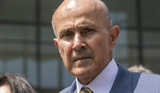 FILE - In this May 12, 2017, file photo, former Los Angeles County Sheriff Lee Baca leaves federal court in Los Angeles after he was sentenced to three years in prison for obstructing an FBI investigation into abuses at the jails he ran. Baca's attorneys filed the request with the 9th U.S. Circuit Court of Appeals Monday, July 24, a day before the 74-year-old former sheriff was scheduled to report to prison for a three-year sentence. (AP Photo/Damian Dovarganes, File)