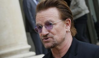 Founder of the non-governmental organization ONE, U2 singer Bono speaks to the media after a meeting at the Elysee Palace, in Paris, France, Monday, July 24, 2017. French President Emmanuel Macron has received pop singer and philanthropist Bono at the Elysee Palace in Paris for talks about poverty.(AP Photo/Michel Euler)