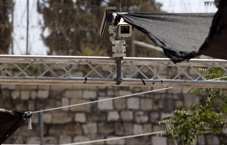 """New security cameras are installed at the entrance to the Al Aqsa Mosque compound, in Jerusalem's Old City, Sunday, July 23, 2017. Israel installed the cameras Sunday at the entrance to a sensitive Jerusalem holy site, as officials began indicating it was considering """"alternatives"""" to the metal detectors at the contested shrine that set off a weekend of violence and raised tensions in the region. (AP Photo/Mahmoud Illean)"""