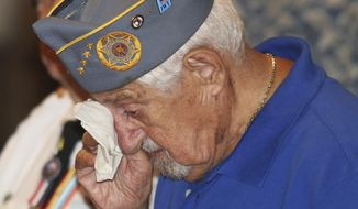 World War II veteran Sam Greenberg dabs his eyes during an emotional moment at the Korea War program at the Luzerne County Courthouse.on Saturday, July 22, 2017, in Wilkes Barre Pa. Greenberg's brother Martin, who was a decorated medic during the Korean War, passed away this past February. Greenberg attended in his place. (Dave Scherbenco/The Citizens' Voice via AP)