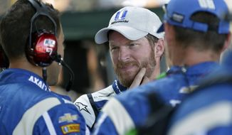 Dale Earnhardt Jr. (88) talks with his crew after dropping out of the NASCAR Brickyard 400 auto race at Indianapolis Motor Speedway in Indianapolis, Sunday, July 23, 2017. (AP Photo/AJ Mast)