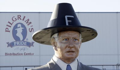 """FILE - In this Dec. 2, 2008 file photo, a statue of Pilgrim's Pride founder Lonnie """"Bo"""" Pilgrim is displayed outside the distribution center near Pittsburg, Texas. Pilgrim, who grew a one-time feed store into the world's largest poultry producer before losing the company in bankruptcy, has died at 89. A statement on the Erman Smith Funeral Home website says Pilgrim died Friday, July 21, 2017, at his Pittsburg home. (AP Photo/LM Otero, File)"""