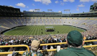 Fans listen to President and CEO Mark Murphy at the annual Green Bay Packers shareholders' meeting at Lambeau Stadium on Monday, July 24, 2017, in Green Bay, Wis. (Adam Wesley/The Post-Crescent via AP)