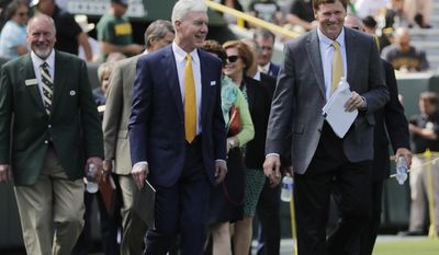 Packers President & CEO Mark Murphy and General Manager Ted Thompson lead the board onto the field at the annual Green Bay Packers shareholders' meeting at Lambeau Stadium on Monday, July 24, 2017, in Green Bay, Wis. (Adam Wesley/The Post-Crescent via AP)