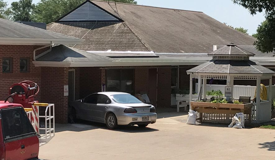 A car is seen outside the Alcester Care and Rehab Center after it slammed into a group of people and crashed into the center Monday, July 24, 2017, in Alcester, S.D. Authorities said at least two people were killed and multiple others injured. A Highway Patrol spokesman said the investigation is ongoing, but the crash appears to have been accident. The driver of the vehicle was among those brought to a hospital. (Trevor Mitchell/Argus Leader via AP)