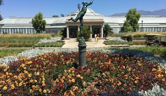 This July 2, 2017 photo shows the entrance to The Huntington Library Art Collections & Botanical Gardens in Pasadena, Calif. The Huntington is a top cultural attraction in the greater Los Angeles area and home to one of the finest collections of British portraiture in the world. (Kelsey Delehanty via AP)