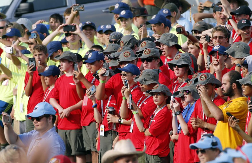 Scouts and their leaders listen to President Donald Trump at the 2017 National Boy Scout Jamboree at the Summit in Glen Jean, W.Va., Monday, July 24, 2017. (AP Photo/Steve Helber)