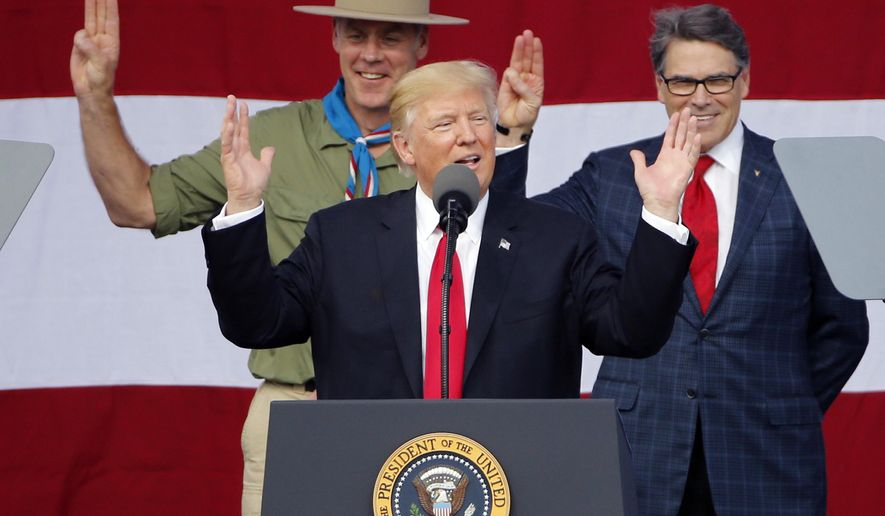 President DonaldTrump, front left, gestures as former boys scouts, Interior Secretary Ryan Zinke, left, Energy Secretary Rick Perry, watch at the 2017 National Boy Scout Jamboree at the Summit in Glen Jean,W. Va., Monday, July 24, 2017. (AP Photo/Steve Helber)