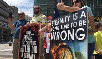 """Operation Save America, a group of pro-life activists, gather during a rally in Louisville, Kentucky. Pro-life activists will show a graphic abortion video on a Jumbotron to """"raise awareness about abortion."""" (Associated Press)"""