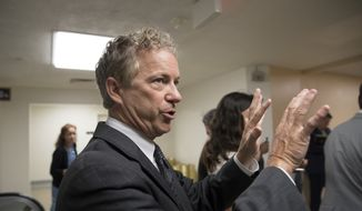 Sen. Rand Paul, R-Ky. answers questions from reporters as he arrives on Capitol Hill in Washington, Tuesday, July 25, 2017, before a test vote on the Republican health care bill. The bill has faced opposition and challenges within the Republican ranks, including by Paul. (AP Photo/J. Scott Applewhite)