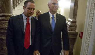 Vice President Mike Pence, center, and White House Chief of Staff Reince Priebus, left, arrive on Capitol Hill in Washington, Tuesday, July 25, 2017, for the Senate vote on health care legislation. (AP Photo/Andrew Harnik)