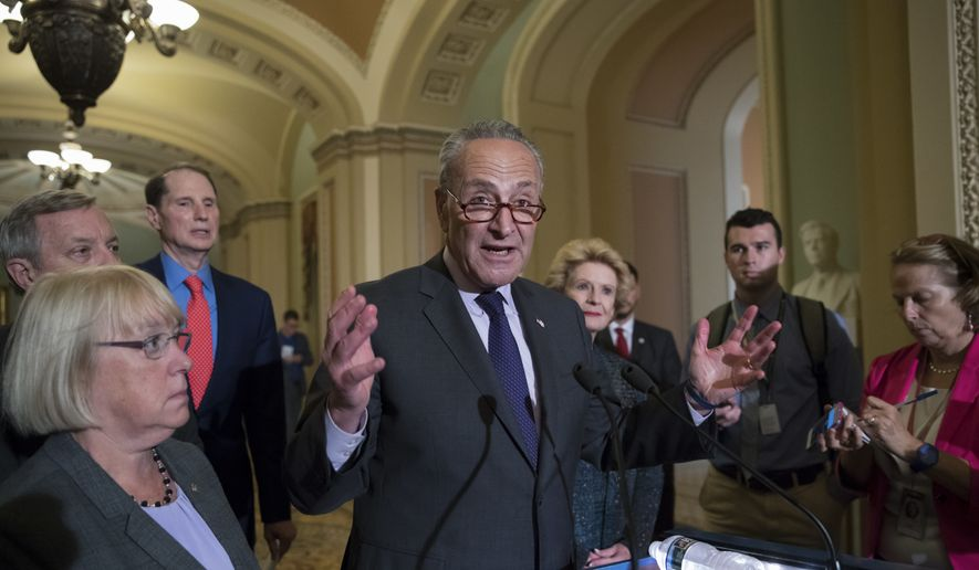 Seate Minority Leader Chuck Schumer, D-N.Y., joined from left by, Sen. Patty Murray, D-Wash., Sen. Dick Durbin, D-Ill., Sen. Ron Wyden, D-Ore., and Sen. Debbie Stabenow, D-Mich., speaks with reporters outside the chamber after Vice President Mike Pence broke a 50-50 tie to start debating Republican legislation to tear down much of the Obama health care law, on Capitol Hill in Washington, Tuesday, July 25, 2017. (AP Photo/J. Scott Applewhite) ** FILE **