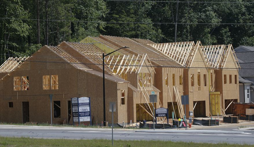 This Tuesday, May 16, 2017, photo shows new town homes under construction in Woodstock, Ga. The Standard & Poor's/Case-Shiller 20-city home price index for May is released, Tuesday, July 25, 2017. (AP Photo/John Bazemore)