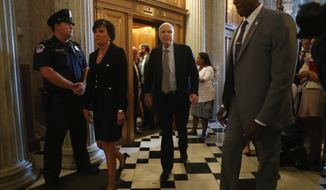 Sen. John McCain, R-Ariz. arrive on Capitol Hill in Washington, Tuesday, July 25, 2017, as the Senate was to vote on moving head on health care with the goal of erasing much of Barack Obama's law.  (AP Photo/Andrew Harnik)