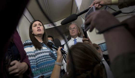 White House press secretary Sarah Huckabee Sanders, left, joined by Secretary of Health and Human Services Tom Price, speaks to media aboard Air Force One, Monday, July 24, 2017, in Andrews Air Force Base, Md., en route to the 2017 National Scout Jamboree in Glen Jean, W.Va. (AP Photo/Carolyn Kaster)