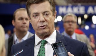 FILE - In this July 17, 2016 file photo, then-Trump Campaign Chairman Paul Manafort talks to reporters on the floor of the Republican National Convention in Cleveland. The Senate Judiciary Committee has issued a subpoena to former Trump campaign manager Paul Manafort seeking his testimony at a public hearing on Wednesday, July 26, 2017.  (AP Photo/Matt Rourke, File)