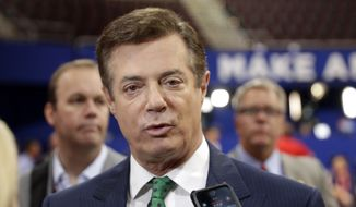 In this July 17, 2016, file photo, then-Trump Campaign Chairman Paul Manafort talks to reporters on the floor of the Republican National Convention in Cleveland. (AP Photo/Matt Rourke, File)